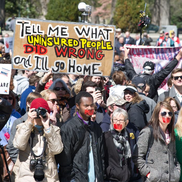 Demonstrators stand outside the US Supreme Court in Washington, DC after the morning session March 27, 2012.