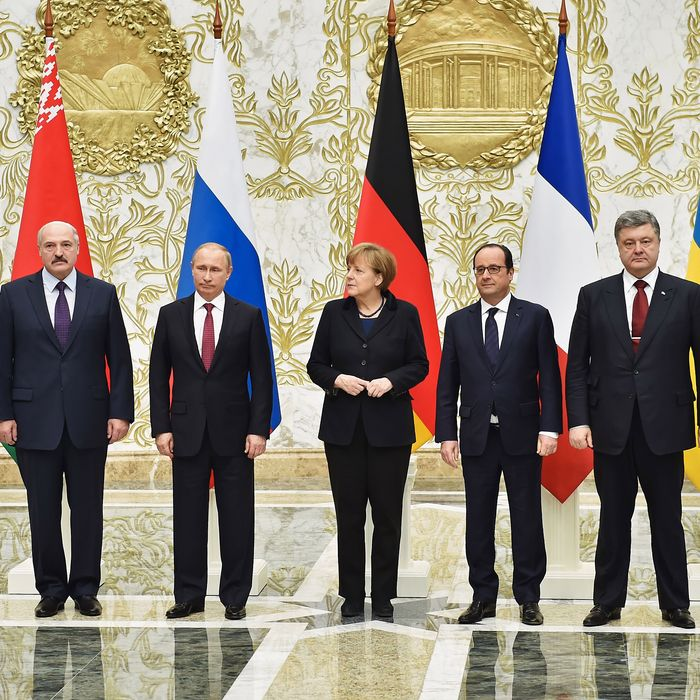 MISNK, BELARUS - FEBRUARY 11: (L to R) Belarus President Alexander Lukashenko, Russian President Vladimir Putin, German Chancellor Angela Merkel, French President Francois Hollande and Ukrainian President Pyotr Poroshenko taking a photograph during peace talks over Eastern Ukraine on February 11, 2015 in Minsk, Belarus