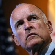 MOUNTAIN VIEW, CA - SEPTEMBER 25:  California Gov. Jerry Brown looks on during a news conference at Google headquarters on September 25, 2012 in Mountain View, California.  California Gov. Jerry Brown signed State Senate Bill 1298 that allows driverless cars to operate on public roads for testing purposes. The bill also calls for the Department of Motor Vehicles to adopt regulations that govern licensing, bonding, testing and operation of the driverless vehicles before January 2015.  (Photo by Justin Sullivan/Getty Images)