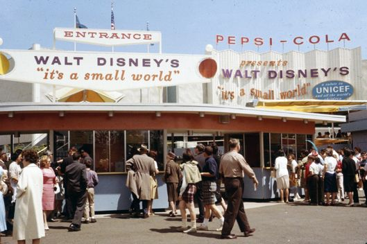 "This 1964 photo released by Disney shows people at the ""it's a small world"" attraction from the 1964 World's Fair in New York. Disney is marking the 50th anniversary of the ride's debut at the fair with a website, SmallWorld50.com, that invites the public to post videos of themselves singing the ride theme song. (AP Photo/Disney)"