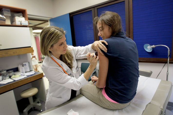 A girl gets the HPV vaccine.