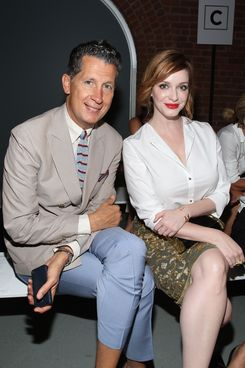 NEW YORK, NY - SEPTEMBER 10:  Stefano Tonchi and Christina Hendricks attend the Wes Gordon presentation during Mercedes-Benz Fashion Week Spring 2014 on September 10, 2013 in New York City.  (Photo by Mireya Acierto/Getty Images)