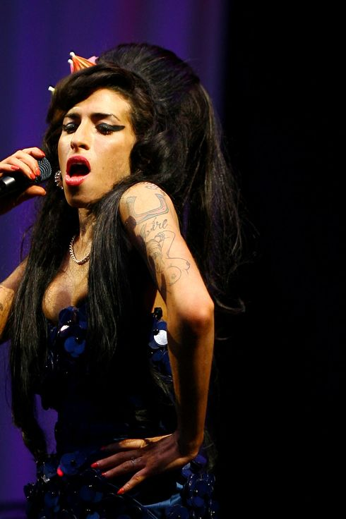 TO GO WITH AFP STORY BY PAUL RICARD   British singer Amy Winehouse performs at the Glastonbury Festival at Worthy Farm, in Glastonbury on June 28, 2008.  As the legendary Motown label turns 50, soul music is back and booming, ever since British diva Amy Winehouse hit world charts two years ago.  The celebrated label , that brought Marvin Gaye, Stevie Wonder and Diana Ross to the world has been marked by a re-issue of its seminal tracks. AFP PHOTO/BEN STANSALL (Photo credit should read BEN STANSALL/AFP/Getty Images)