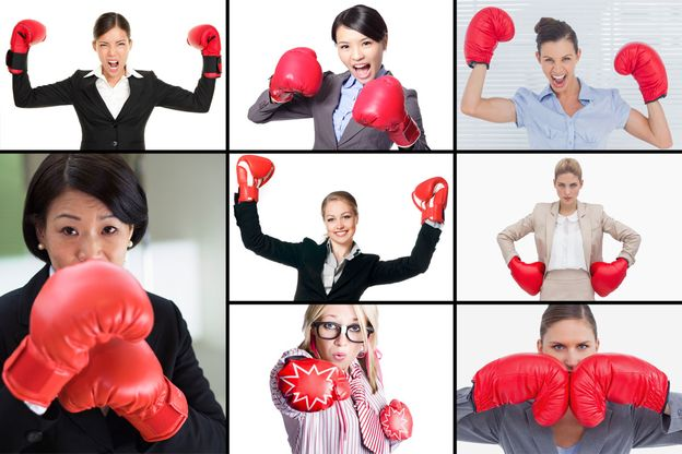 Photo 1 from Women wearing boxing gloves with business attire.
