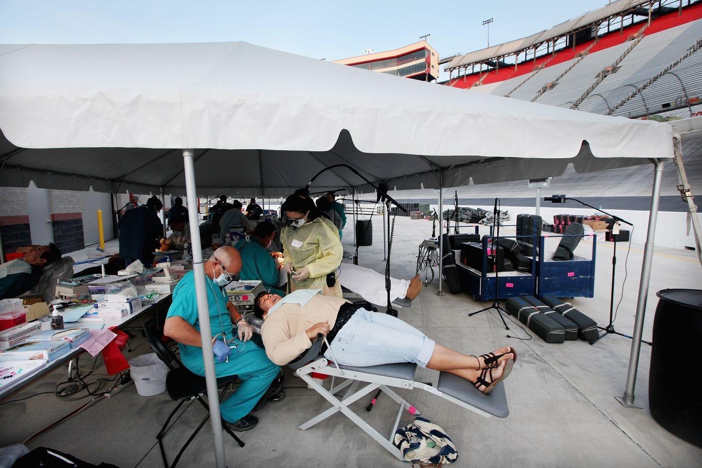 Uninsured patient Patricia Breto receives dental care from volunteers Dr. David Reczek of Boston and dental student Yasmin Gonzalez from Champaign, Illinois at the Remote Area Medical (RAM) free clinic at the Bristol Motor Speedway, located in the mountains of Appalachia, on April 15, 2012 in Bristol, Tennessee. More than one thousand uninsured and underinsured people received free medical, dental, vision and pulmonary treatments provided by volunteer doctors, dentists, optometrists, nurses and support staff during the three day clinic in the foothills of the Appalachian Mountains, one of the poorest regions in the country. The U.S. Supreme Court recently heard arguments over the constitutionality of President Obama's sweeping health care overhaul.