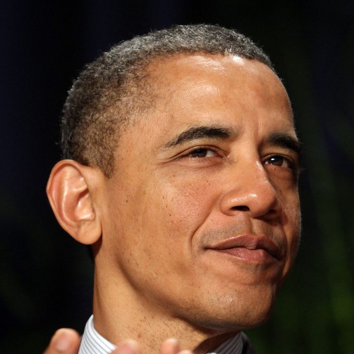 U.S. President Barack Obama applauds at the National Prayer Breakfast February 2, 2012 in Washington, DC.