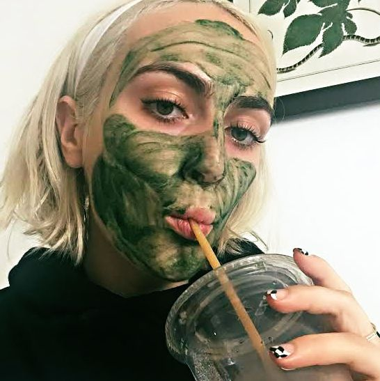 The author in her Chlorophyll mask drinking a green juice.
