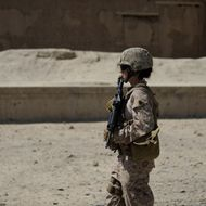 US Female Marine, Gunnery Sargeant Michelle Mollen of the 2nd Battalion, 1st Marines Regiment patrols in Garmser, Helmand Province, Afghanistan on March 12, 2011.There are around 140,000 international troops, two-thirds of them from the United States, in Afghanistan fighting the militant Islamist Taliban. AFP PHOTO/ADEK BERRY (Photo credit should read ADEK BERRY/AFP/Getty Images)