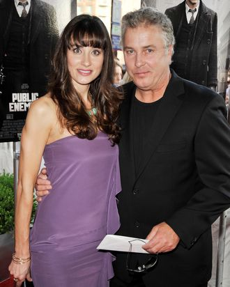 Actor William Peterson (R) and his wife Gina Cirone arrive at the premiere of Universal Pictures'