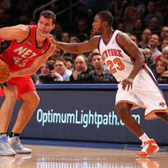 NEW YORK, NY - DECEMBER 21:  Kris Humphries #43 of the New Jersey Nets dribbles the ball as Toney Douglas #23 of the New York Knicks defends during their pre season game  at Madison Square Garden on December 21, 2011 in New York City.  NOTE TO USER: User expressly acknowledges and agrees that, by downloading and or using this photograph, User is consenting to the terms and conditions of the Getty Images License Agreement. (Photo by Al Bello/Getty Images)