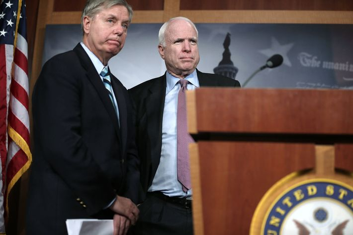 WASHINGTON, DC - FEBRUARY 14:  U.S. Senator John McCain (R-AZ) (R), and Senator Lindsey Graham (R-SC) (L) speak to the press during a news conference on the terror attack that killed four Americans in Benghazi February 14, 2013 on Capitol Hill in Washington, DC. The senators questioned why the Obama Administration did not seek enough help from the Libya government during the attack.  (Photo by Alex Wong/Getty Images)