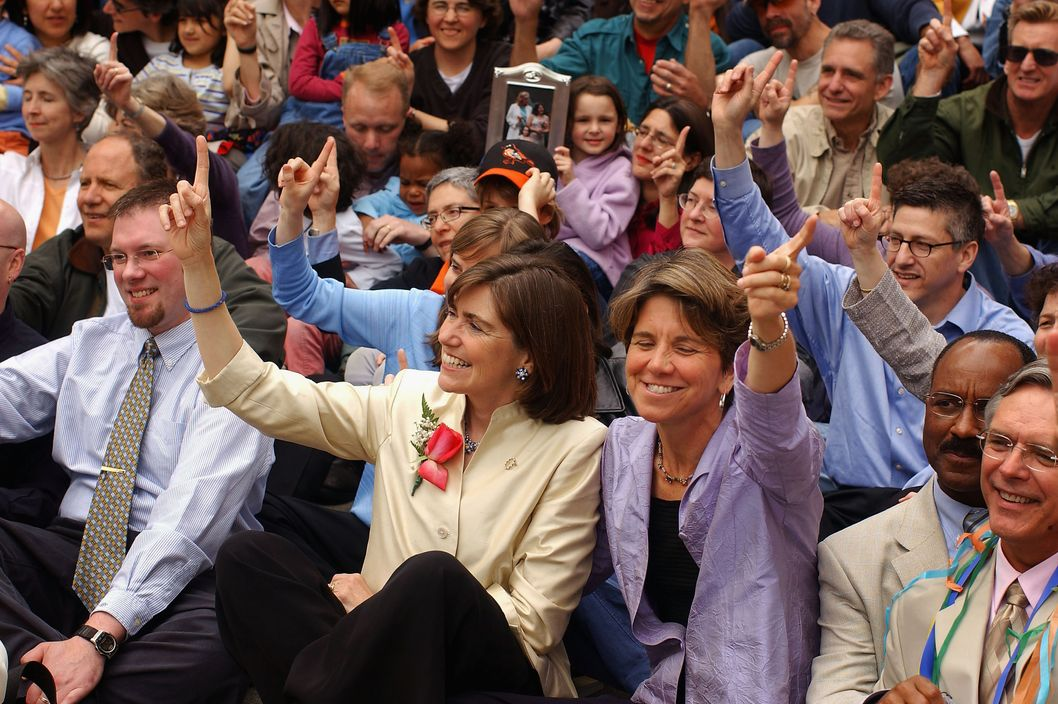 Julie (L) and Hillary Goodridge attend a group photo on May 17, 2005 to celebrate the first anniversary of the passing of the same sex marriage law in front of the State House in Boston, Massachusetts. The Goodridges were the first couple to be married under the law in the state of Massachusetts.