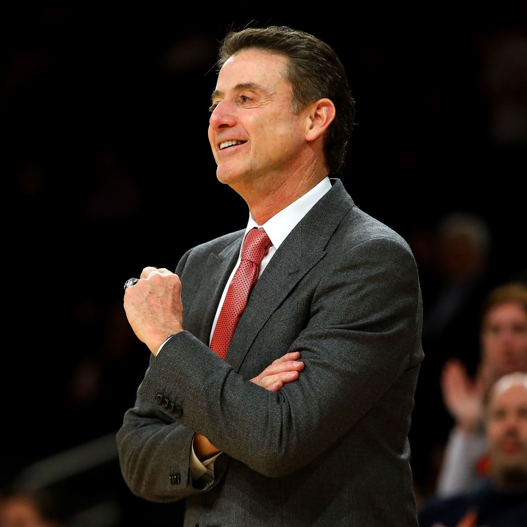 Head coach Rick Pitino of the Louisville Cardinals smiles against the Notre Dame Fighting Irish during the semifinals of the Big East Men's Basketball Tournament at Madison Square Garden on March 15, 2013 in New York City.