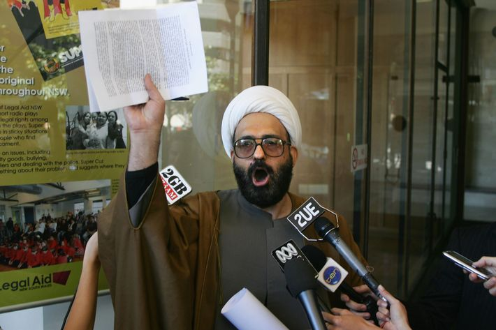 A picture made available 15 December 2014 shows muslim cleric Man Haron Monis speaking to the media after leaving Downing Centre Local Court after he had been charged with seven counts of unlawfully using the postal service to menace, after sending harassing letters to families of Australian soldiers, in Sydney, Australia, 10 November 2009.  According to news reports on 15 December 2014 citing police, Man Haron Monis has allegedly been identified by police as the hostage-taker at a cafe in downtown Sydney, Australia. A number of hostages were being held inside a Lindt cafe, after witnesses reported gunshots and footage showed an Islamist flag held up to the window.  EPA/SERGIO DIONISIO AUSTRALIA AND NEW ZEALAND OUT