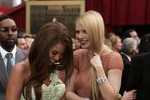 Singer Beyonce and actress Gwyneth Paltrow arrive at the 79th Academy Awards in Hollywood, California