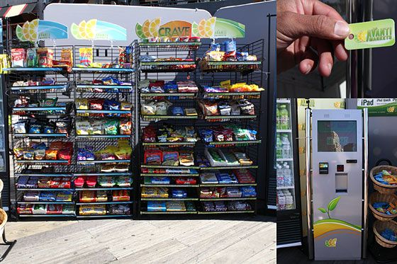 An unmanned convenience store kiosk with self-checkout and an emphasis on gourmet food, healthy choices, and non-soda beverages.<br><br><br>