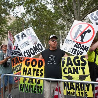 NEW YORK, NY - JULY 24: Anti Gay marriage protesters from the Westboro Baptist Church attend the first day of legal same-sex marriage in New York State on July 24, 2011 in New York City.