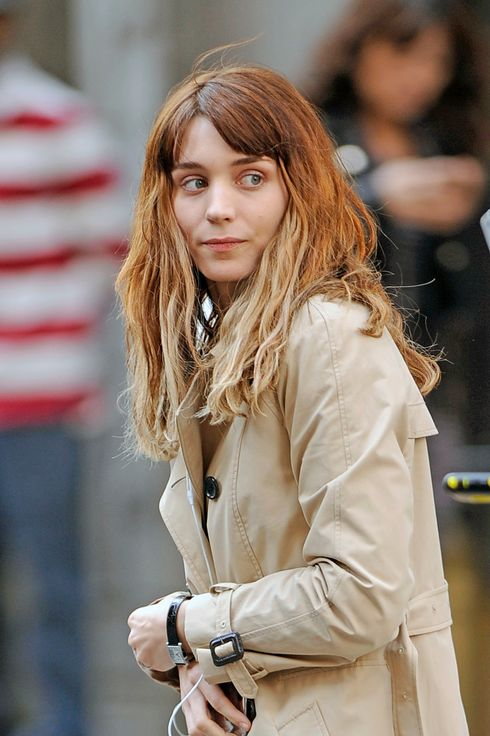 Rooney Mara listens to music on her phone while walking to the set of her new movie, 'The Bitter Pill' in New York City.