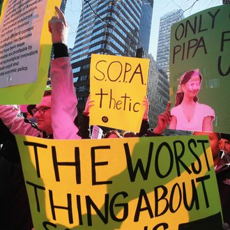Protesters demonstrate against the proposed Stop Online Piracy Act (SOPA) and Protect IP Act (PIPA) outside the offices of U.S. Sen. Charles Schumer (D-NY) and U.S. Sen. Kirsten Gillibrand (D-NY) on January 18, 2012 in New York City. The controversial legislation is aimed at preventing piracy of media but those opposed believe it will support censorship.