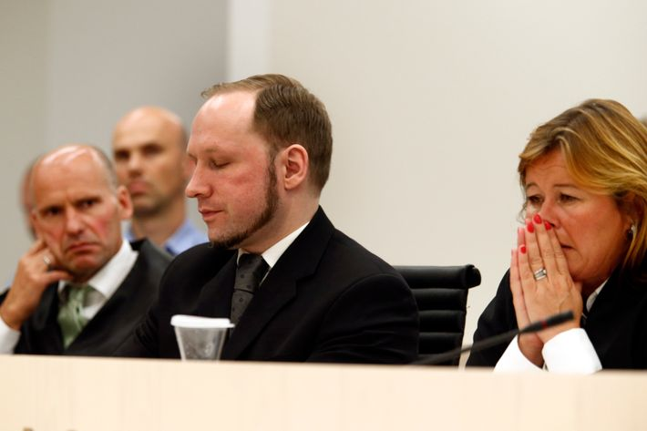 Defender Geir Lippestad (left) and defender Vibeke Hein Baera sit together with terror accused Anders Behring Breivik when Oslo Court passes judgment against him in Oslo Courthouseon August 24, 2012. The court on Friday found Anders Behring Breivik guilty of