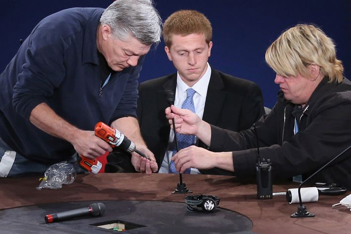 DANVILLE, KY - OCTOBER 10: Technicians screw a microphone in place as a student (C) from Centre College stands in for Vice President Joe Biden during lighting tests on stage at the college October 10, 2012 in Danville, Kentucky. Biden and Republican vice presidential nominee Rep. Paul Ryan (R-WI) will participate in the one and only vice presidential debate of the election tomorrow. (Photo by Chip Somodevilla/Getty Images)
