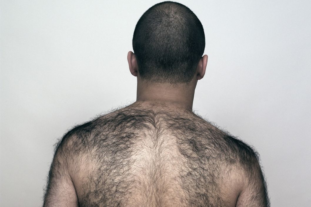 Rear View of a man With a Hairy Back.