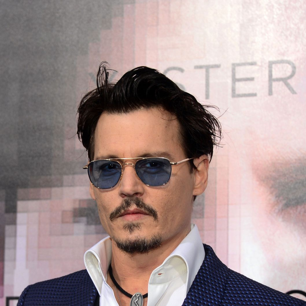Actor Johnny Depp poses on arrival for the Los Angeles Premiere of the film 'Transcendence' on April 10, 2014 in Los Angeles, California. The film opens nationwide on April 18. AFP PHOTO/Frederic J. BROWN        (Photo credit should read FREDERIC J. BROWN/AFP/Getty Images)