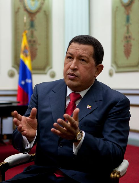 Venezuelan President Hugo Chavez (C) holds the sword of South American liberator Simon Bolivar while speaking to supporters after receiving news of his reelection in Caracas on October 7, 2012. According to the National Electoral Council, Chavez was reelected with 54.42% of the votes, beating opposition candidate Henrique Capriles, who obtained 44.47%.