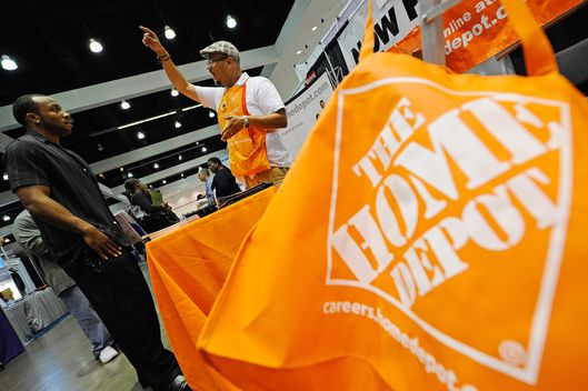 A job seeker listens to The Home Depot recruiter Andrew Rodriguez at the Diversity Job Fair during the NAACP's 102nd annual national convention at the Los Angeles Convention Center on July 27, 2011 in Los Angeles, California.  California's state unemployment rate for June rose slightly to 11.8 percent, even as employers added workers.