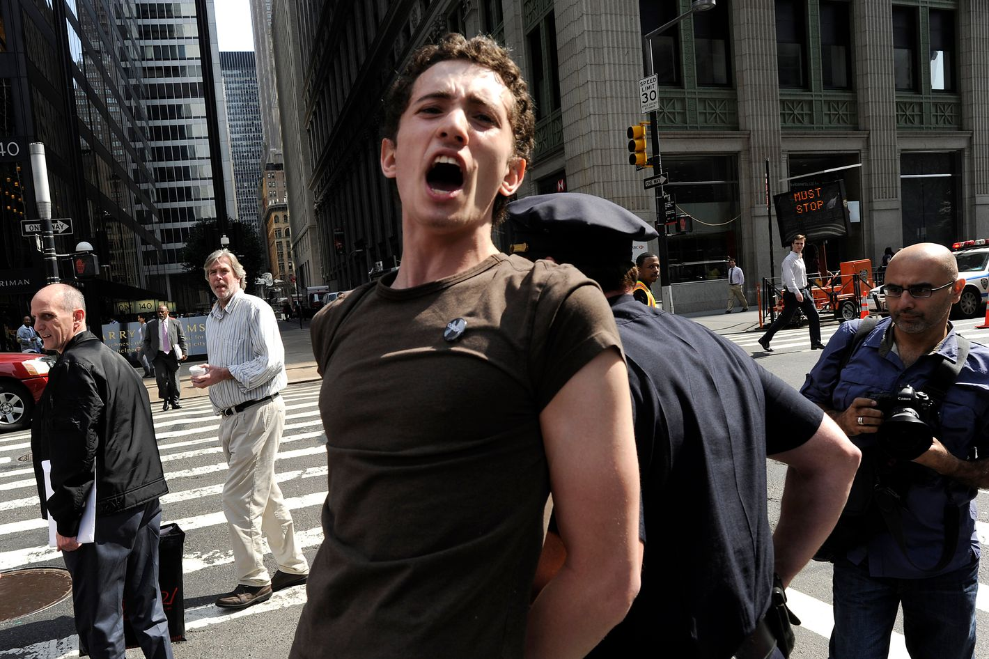 A demonstrator with 'Occupy Wall Street' is arrested during a protest at Zuccotti Park in New York on March 23, 2012 .