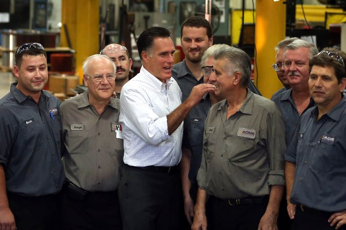 Republican presidential candidate and former Massachusetts Gov. Mitt Romney chats with workers during a campaign event at Acme Industries on August 7, 2012 in Elk Grove Village, Illinois.