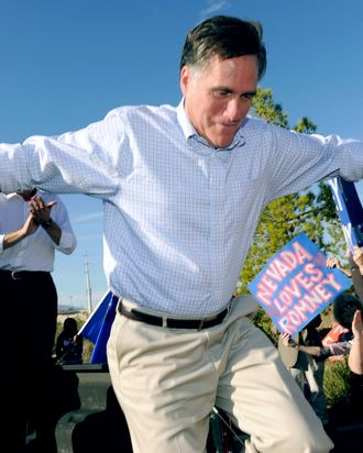 LAS VEGAS, NV - OCTOBER 17: Former Massachusetts Gov. and Republican presidential hopeful Mitt Romney jumps off the back of a pickup truck after speaking to supporters as he opens his Nevada campaign headquarters October 17, 2011 in Las Vegas, Nevada. Romney and six other presidential contenders will participate in a debate airing on CNN, sponsored by the Western Republican Leadership Conference in Las Vegas on October 18. (Photo by Ethan Miller/Getty Images)