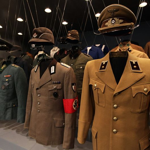 BERLIN - OCTOBER 13:  Uniforms of Nazi criminal Adolf Hitler and his regime are pictured during a press preview of 'Hitler and the Germans Nation and Crime' (Hitler und die Deutschen Volksgemeinschaft und Verbrechen) at Deutsches Historisches Museum (German Historical Museum) on October 13, 2010 in Berlin, Germany. The exhibition seeks to answer the question of why so many Germans chose to follow Hitler and his fascist ideology and so devotedly despite the horrors of World War II and the Holocaust. The exhibition will be open to the public from October 15 until February 6, 2011.  (Photo by Andreas Rentz/Getty Images)