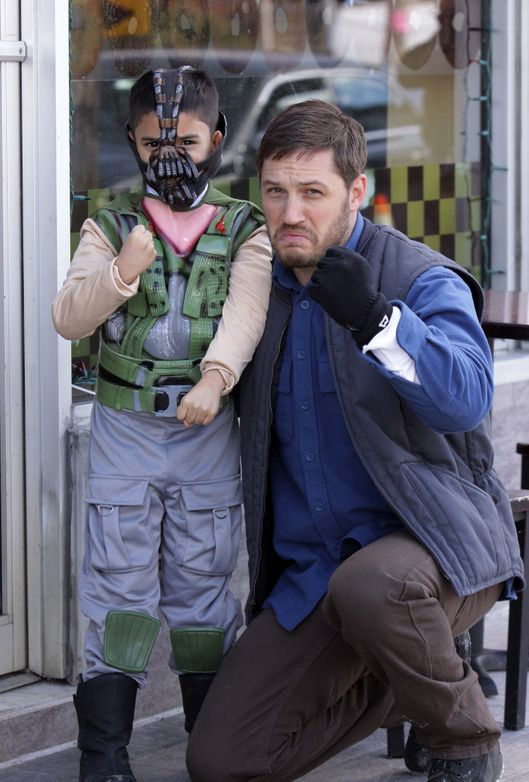 Tom Hardy pictured taking a photograph with a child dressed as 'Bane' while taking a break on the set of the 'Animal Rescue' movie in Flatlands Avenue in Brooklyn, NYC.<P>Pictured: Tom Hardy<P><B>Ref: SPL517358  020413  </B><BR/>Picture by: Jose Perez / Splash News<BR/></P><P><B>Splash News and Pictures</B><BR/>Los Angeles:	310-821-2666<BR/>New York:	212-619-2666<BR/>London:	870-934-2666<BR/>photodesk@splashnews.com<BR/></P>