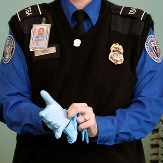 A TSA agent dons rubber gloves at Washington Reagan National Airport
