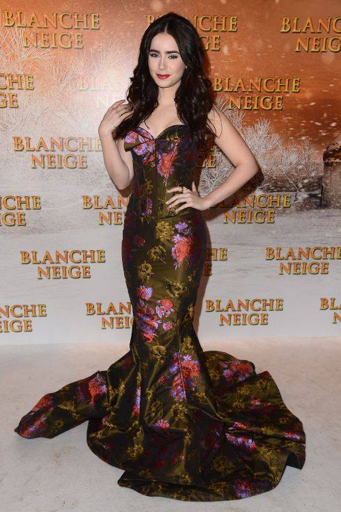 Lilly Collins attends the 'Blanche Neige' Paris Premiere at Gaumont Capucines on April 1, 2012 in Paris, France.