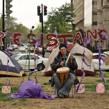 A man plays percussion during the Occupy DC carnival at McPherson Square in Washington on March 31, 2012.