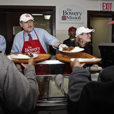 Mayoral candidate JOE LHOTA and his wife TAMRA serve food to those in need at The Bowery Mission in Manhattan, New York.