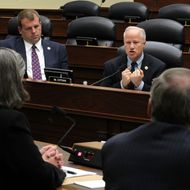 U.S. Rep. Mike Coffman (R-CO) (R) speaks as Rep. Jon Runyan (R-NJ) (L) listens during a hearing before the Oversight and Investigations Subcommittee of the House Armed Services Committee April 14, 2011 on Capitol Hill in Washington, DC.