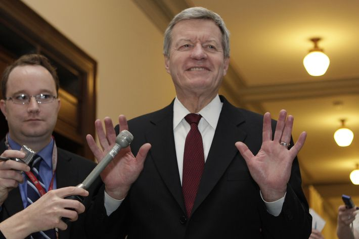 """Super committee member Senator Max Baucus (D-MT) gestures to the media as he arrives at the  meeting between Republican and Democratic members of the """"Super Committee"""", or Joint Select Committee on Deficit Reduction, on November 21, 2011 on Capitol Hill in Washington, DC. Members of the committee have struggled to come up with a plan to cut at least $1.2 trillion of the federal deficit over the next ten years.AFP PHOTO/YURI GRIPAS (Photo credit should read YURI GRIPAS/AFP/Getty Images)"""