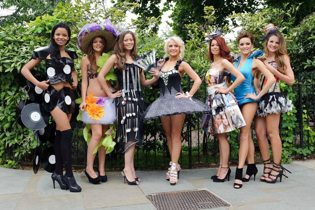 From left, Rissikat Bade, Miss London, Shiralee Gould, Miss Weymouth, Laura Gregory, Miss Middlesex, Bethany Tamsett, Miss Essex, Sophie Chryssaphes, Miss Hertfordshire, Natalie Cutler, Miss Birmingham and Hannah Higgins, Miss South Yorkshire, pose for photographers, in a central London venue, Tuesday July 12, 2011. The seven Miss England 2011 finalists are showcasing their self-created Eco outfits that have been sourced from recycled clothing and object. (AP Photo/Jonathan Short)