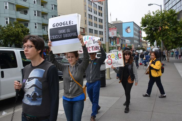 San Francisco, United States. 25th June 2014 -- A woman pickets with a 'Google: be a new hope' sign during a 'Star Wars' themed protest outside Moscone West during the Google I/O conference opening keynote. -- A Star Wars themed 'Don't be evil' protest was held outside Moscone West as the Google I/O conference opened. People protested on issues of eviction and Google buses, wages for security guards working at Google and taxation.