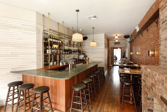 The bar is fronted with California redwood.