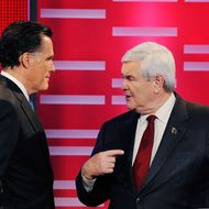 DES MOINES, IA - DECEMBER 10:  Former Massachusetts Gov. Mitt Romney (L) and former speaker of the House Newt Gingrich, speak during the ABC News GOP Presidential debate on the campus of Drake University on December 10, 2011 in Des Moines, Iowa. Rivals were expected to target front runner Gingrich in the debate hosted by ABC News, Yahoo News, WOI-TV, The Des Moines Register and the Iowa GOP.  (Photo by Kevork Djansezian/Getty Images)