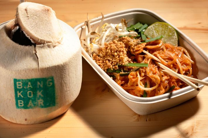 Bangkok B.A.R.'s chicken pad Thai and coconut drink.
