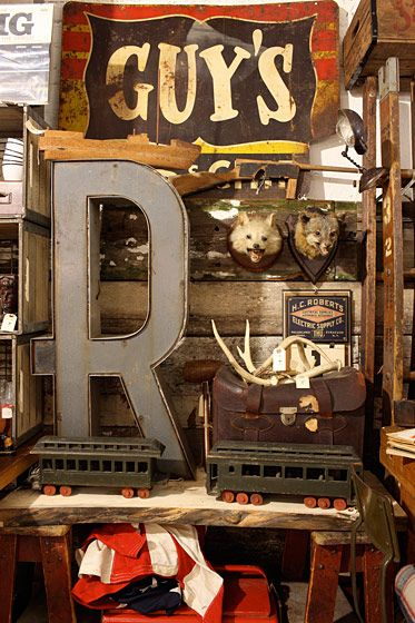 Three Potato Four pressed-steel oversize letters, $250; deer antlers, $15 to $35; vintage lawyer satchel, $200; early-twentieth-century fox heads, $200.