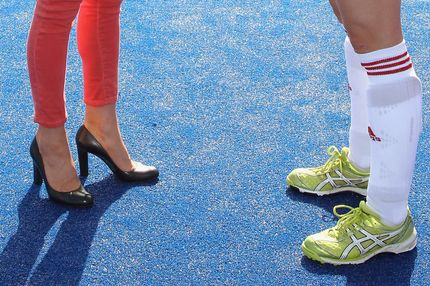 A picture shows the shoes of Britain's Catherine, Duchess of Cambridge (L) and women's Team GB hockey captain Kate Walsh (R) as they talk during a visit by the duchess to the Riverside Arena at the Olympic Park in London on March 15, 2012.