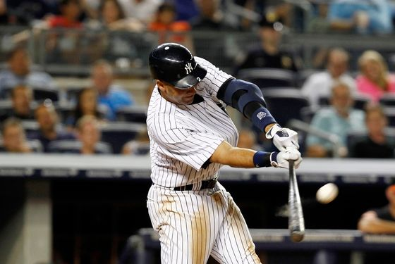 NEW YORK - AUGUST 31: Derek Jeter #2 of the New York Yankees bats against the Baltimore Orioles in a game at Yankee Stadium on August 31, 2012 in the Bronx Borough of New York City. (Photo by Jeff Zelevansky/Getty Images)