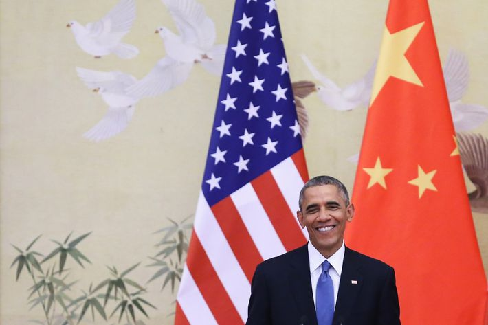 U.S. President Barack Obama answers media's question during a press conference with Chinese President Xi Jinping at the Great Hall of People on November 12, 2014 in Beijing, China. U.S. President Barack Obama pays a state visit to China after attending the 22nd Asia-Pacific Economic Cooperation (APEC) Economic Leaders' Meeting.
