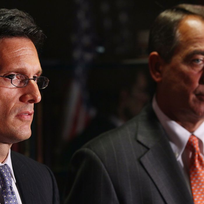 WASHINGTON, DC - JULY 26: House Majority Leader Eric Cantor (R-VA) (L) and Speaker of the House John Boehner (R-OH) hold a news conference after a meeting at the Republican National Committee offices July 26, 2011 in Washington, DC. During the height of battle between Congressional Republicans and the White House, Boehner introduced legislation Monday that would raise the debt ceiling in two stages and cut $3 trillion in budget cuts. (Photo by Win McNamee/Getty Images)